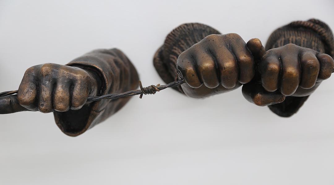A closeup detail of the bronze sculpture.