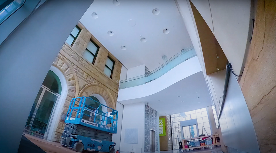 Wide angle still of the Museum's lobby moments before installation of Pae White's new mobile.